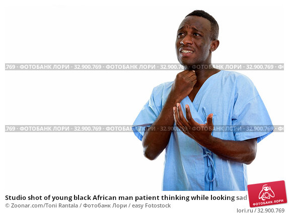Studio shot of young black African man patient thinking while looking sad and having sore throat. Стоковое фото, фотограф Zoonar.com/Toni Rantala / easy Fotostock / Фотобанк Лори