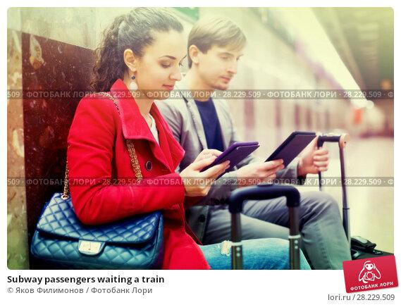 Купить «Subway passengers waiting a train», фото № 28229509, снято 22 июня 2018 г. (c) Яков Филимонов / Фотобанк Лори