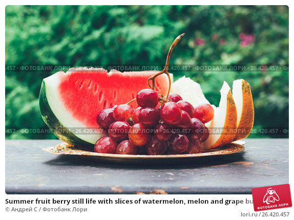 Купить «Summer fruit berry still life with slices of watermelon, melon and grape bunch on the table», фото № 26420457, снято 23 ноября 2017 г. (c) Андрей С / Фотобанк Лори