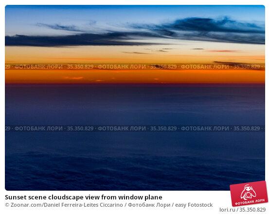 Sunset scene cloudscape view from window plane. Стоковое фото, фотограф Zoonar.com/Daniel Ferreira-Leites Ciccarino / easy Fotostock / Фотобанк Лори