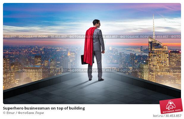 Superhero businessman on top of building. Стоковое фото, фотограф Elnur / Фотобанк Лори