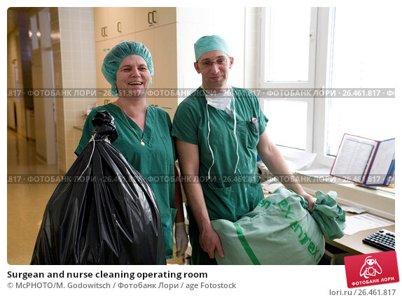 Купить «Surgean and nurse cleaning operating room», фото № 26461817, снято 2 марта 2007 г. (c) age Fotostock / Фотобанк Лори