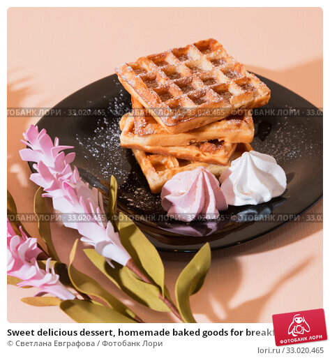 Купить «Sweet delicious dessert, homemade baked goods for breakfast. Belgian European soft waffles on a black plate and meringue», фото № 33020465, снято 30 ноября 2019 г. (c) Светлана Евграфова / Фотобанк Лори