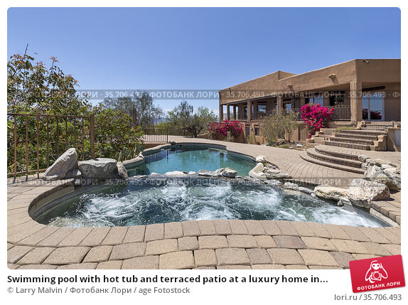 Swimming pool with hot tub and terraced patio at a luxury home in... Стоковое фото, фотограф Larry Malvin / age Fotostock / Фотобанк Лори