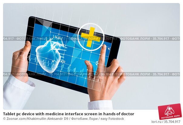 Tablet pc device with medicine interface screen in hands of doctor. Стоковое фото, фотограф Zoonar.com/Khakimullin Aleksandr D9 / easy Fotostock / Фотобанк Лори