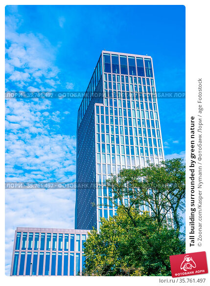 Tall building surrounded by green nature. Стоковое фото, фотограф Zoonar.com/Kasper Nymann / age Fotostock / Фотобанк Лори