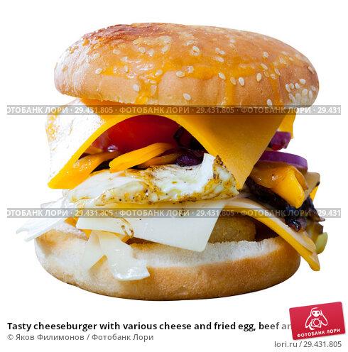 Купить «Tasty cheeseburger with various cheese and fried egg, beef and onion», фото № 29431805, снято 7 декабря 2018 г. (c) Яков Филимонов / Фотобанк Лори