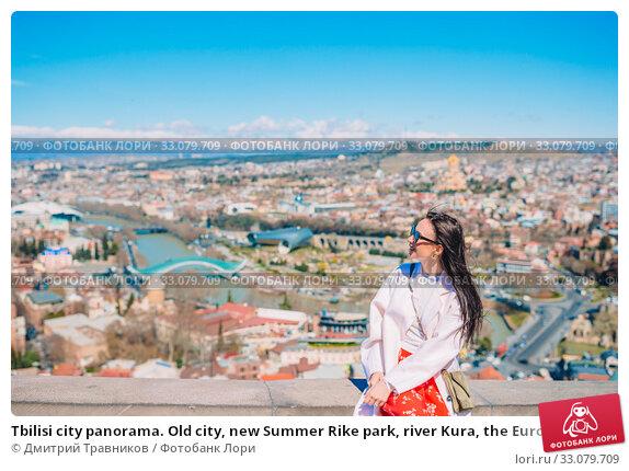 Купить «Tbilisi city panorama. Old city, new Summer Rike park, river Kura, the European Square and the Bridge of Peace», фото № 33079709, снято 21 марта 2019 г. (c) Дмитрий Травников / Фотобанк Лори