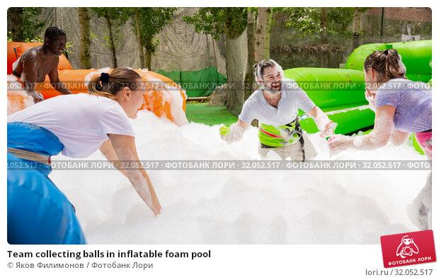 Team collecting balls in inflatable foam pool. Стоковое фото, фотограф Яков Филимонов / Фотобанк Лори