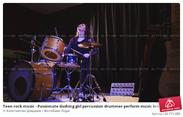 Купить «Teen rock music - Passionate dashing girl percussion drummer perform music break down», фото № 25711085, снято 19 июля 2019 г. (c) Константин Шишкин / Фотобанк Лори
