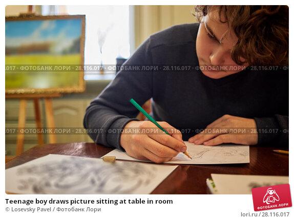 Купить «Teenage boy draws picture sitting at table in room», фото № 28116017, снято 4 февраля 2017 г. (c) Losevsky Pavel / Фотобанк Лори
