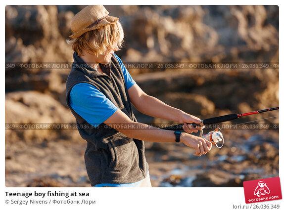 Teenage boy fishing at sea, фото № 26036349, снято 15 апреля 2015 г. (c) Sergey Nivens / Фотобанк Лори