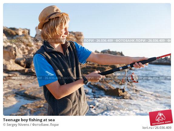 Купить «Teenage boy fishing at sea», фото № 26036409, снято 15 апреля 2015 г. (c) Sergey Nivens / Фотобанк Лори