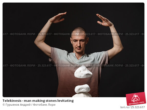 Telekinesis - man making stones levitating. Стоковое фото, фотограф Гурьянов Андрей / Фотобанк Лори