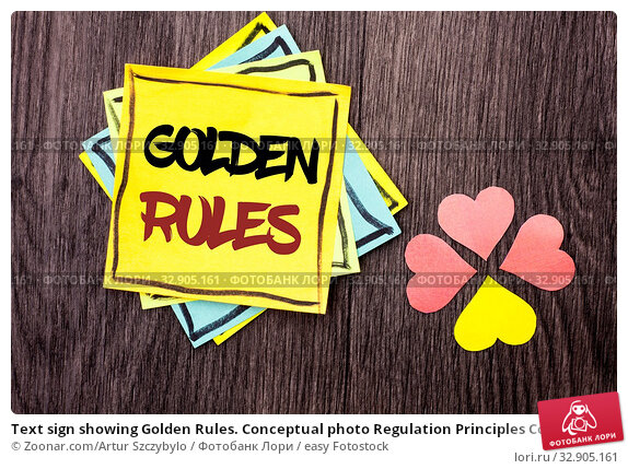 Text sign showing Golden Rules. Conceptual photo Regulation Principles Core Purpose Plan Norm Policy Statement written Stacked Sticky Note Papers the wooden background Hearts next to it. Стоковое фото, фотограф Zoonar.com/Artur Szczybylo / easy Fotostock / Фотобанк Лори