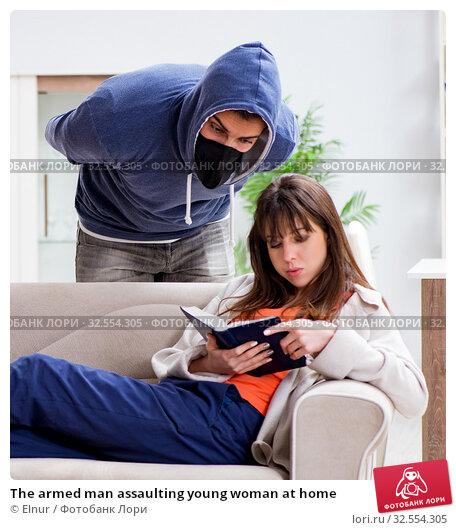 Купить «The armed man assaulting young woman at home», фото № 32554305, снято 15 декабря 2017 г. (c) Elnur / Фотобанк Лори