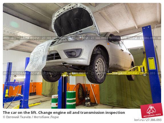 Купить «The car on the lift. Change engine oil and transmission inspection», фото № 27386093, снято 3 марта 2017 г. (c) Евгений Ткачёв / Фотобанк Лори