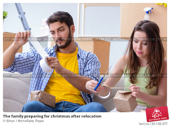 Купить «The family preparing for christmas after relocation», фото № 29138377, снято 10 июля 2017 г. (c) Elnur / Фотобанк Лори