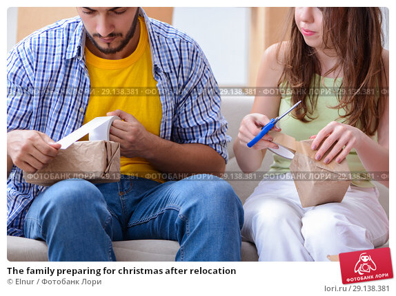 Купить «The family preparing for christmas after relocation», фото № 29138381, снято 10 июля 2017 г. (c) Elnur / Фотобанк Лори