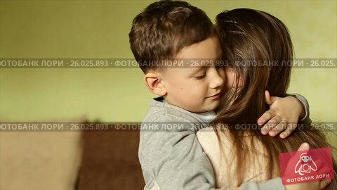 Купить «The happy boy tenderly embraced his mother», видеоролик № 26025893, снято 20 апреля 2017 г. (c) Олег Башкир / Фотобанк Лори