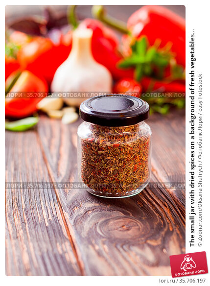 The small jar with dried spices on a background of fresh vegetables... Стоковое фото, фотограф Zoonar.com/Oksana Shufrych / easy Fotostock / Фотобанк Лори