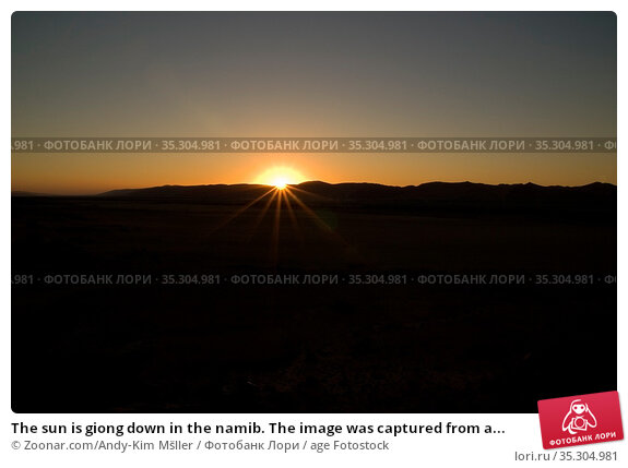The sun is giong down in the namib. The image was captured from a... Стоковое фото, фотограф Zoonar.com/Andy-Kim Mšller / age Fotostock / Фотобанк Лори