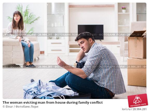 Купить «The woman evicting man from house during family conflict», фото № 28984281, снято 23 марта 2018 г. (c) Elnur / Фотобанк Лори