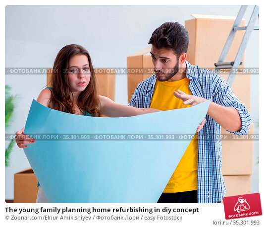 The young family planning home refurbishing in diy concept. Стоковое фото, фотограф Zoonar.com/Elnur Amikishiyev / easy Fotostock / Фотобанк Лори