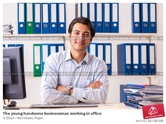 Купить «The young handsome businessman working in office», фото № 29138545, снято 7 июля 2018 г. (c) Elnur / Фотобанк Лори