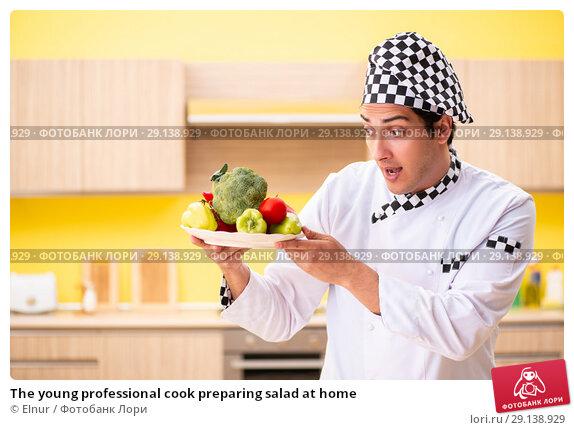 Купить «The young professional cook preparing salad at home», фото № 29138929, снято 13 июня 2018 г. (c) Elnur / Фотобанк Лори