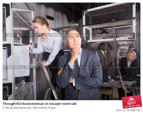 Купить «Thoughtful businessman in escape room lab», фото № 33429161, снято 29 января 2019 г. (c) Яков Филимонов / Фотобанк Лори