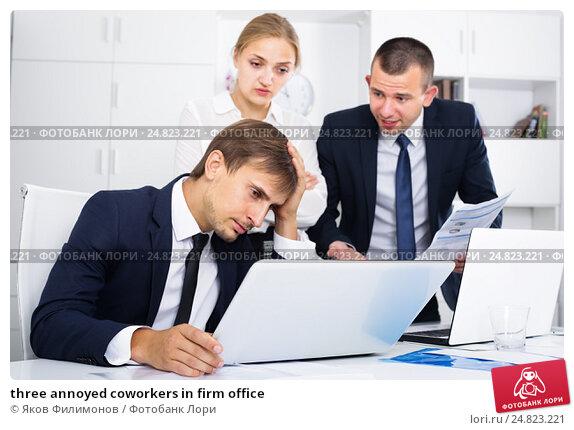 Купить «three annoyed coworkers in firm office», фото № 24823221, снято 16 сентября 2019 г. (c) Яков Филимонов / Фотобанк Лори