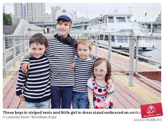 Купить «Three boys in striped vests and little girl in dress stand embraced on embankment», фото № 25838313, снято 23 мая 2015 г. (c) Losevsky Pavel / Фотобанк Лори