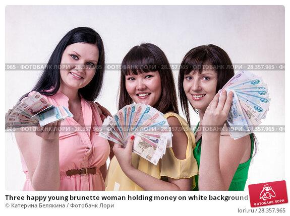 Купить «Three happy young brunette woman holding money on white background», фото № 28357965, снято 11 июля 2014 г. (c) Катерина Белякина / Фотобанк Лори
