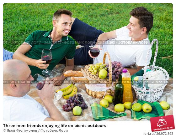 Купить «Three men friends enjoying life on picnic outdoors», фото № 26972393, снято 23 августа 2017 г. (c) Яков Филимонов / Фотобанк Лори