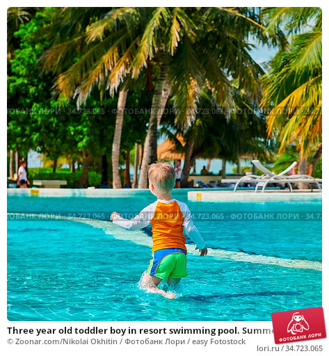 Three year old toddler boy in resort swimming pool. Summer family... Стоковое фото, фотограф Zoonar.com/Nikolai Okhitin / easy Fotostock / Фотобанк Лори