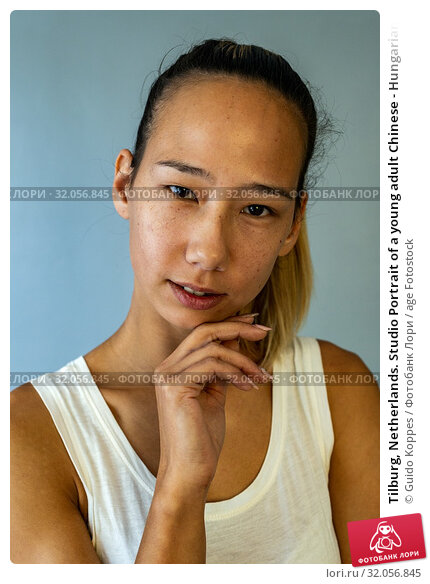 Tilburg, Netherlands. Studio Portrait of a young adult Chinese - Hungarian attractive woman. Стоковое фото, фотограф Guido Koppes / age Fotostock / Фотобанк Лори