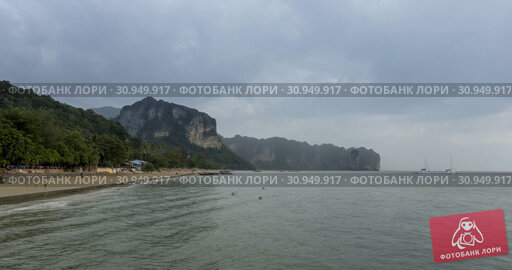 Купить «Time lapse of rain clouds over beach and sea landscape with boats. Tropical storm in ocean.», видеоролик № 30949917, снято 28 апреля 2019 г. (c) Александр Маркин / Фотобанк Лори