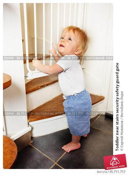 Toddler near stairs security safety guard gate. Стоковое фото, фотограф Сергей Новиков / Фотобанк Лори