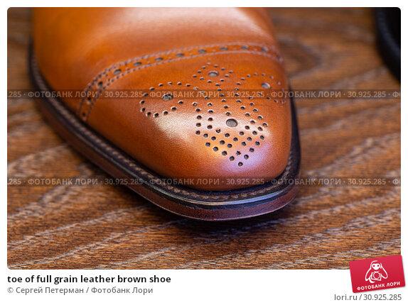Купить «toe of full grain leather brown shoe», фото № 30925285, снято 20 июня 2019 г. (c) Сергей Петерман / Фотобанк Лори