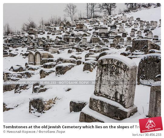 Tombstones at the old Jewish Cemetery which lies on the slopes of Trebevic mountain in Sarajevo capital of Bosnia Herzegovina (2018 год). Редакционное фото, фотограф Николай Коржов / Фотобанк Лори