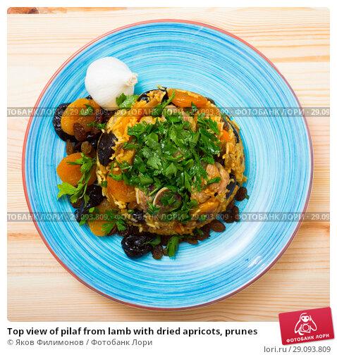 Купить «Top view of pilaf from lamb with dried apricots, prunes», фото № 29093809, снято 16 августа 2018 г. (c) Яков Филимонов / Фотобанк Лори