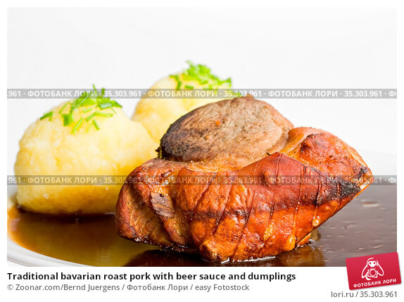 Traditional bavarian roast pork with beer sauce and dumplings. Стоковое фото, фотограф Zoonar.com/Bernd Juergens / easy Fotostock / Фотобанк Лори