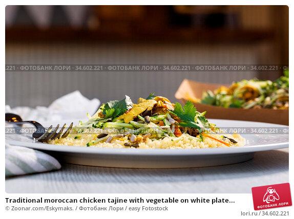 Traditional moroccan chicken tajine with vegetable on white plate... Стоковое фото, фотограф Zoonar.com/Eskymaks. / easy Fotostock / Фотобанк Лори