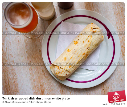 Turkish wrapped dish durum on white plate. Стоковое фото, фотограф Яков Филимонов / Фотобанк Лори