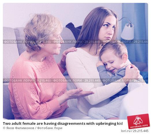 Купить «Two adult female are having disagreements with upbringing kid», фото № 29215445, снято 15 февраля 2018 г. (c) Яков Филимонов / Фотобанк Лори