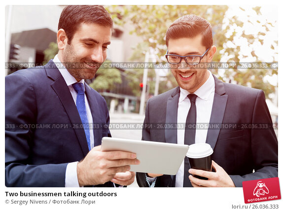 Two businessmen talking outdoors, фото № 26036333, снято 4 апреля 2015 г. (c) Sergey Nivens / Фотобанк Лори