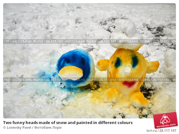 Купить «Two funny heads made of snow and painted in different colours», фото № 28117197, снято 23 февраля 2016 г. (c) Losevsky Pavel / Фотобанк Лори