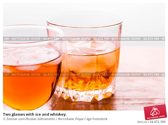 Two glasses with ice and whiskey. Стоковое фото, фотограф Zoonar.com/Ruslan Gilmanshin / age Fotostock / Фотобанк Лори