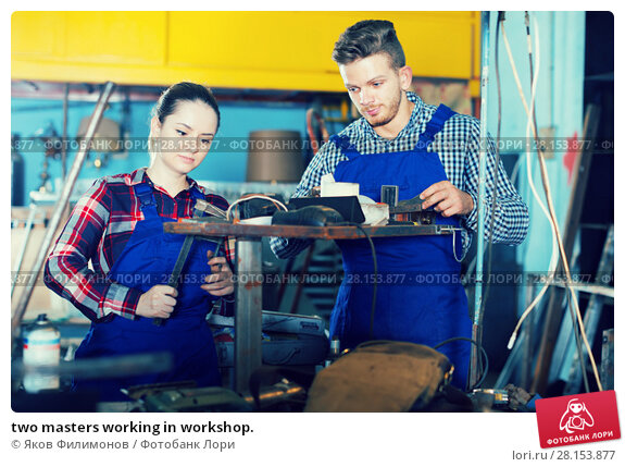 Купить «two masters working in workshop.», фото № 28153877, снято 10 октября 2017 г. (c) Яков Филимонов / Фотобанк Лори